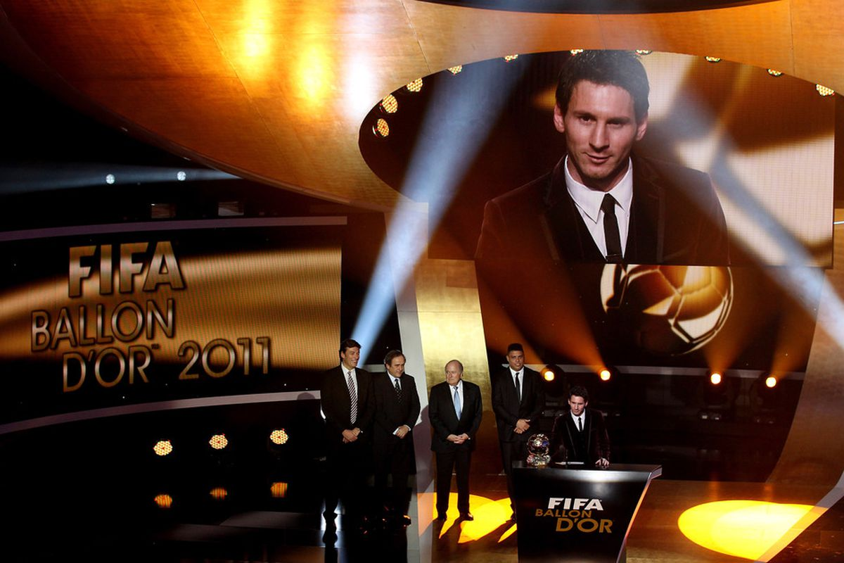ZURICH, SWITZERLAND - JANUARY 09:  Lionel Messi of Barcelona receives the FIFA Ballon d'Or 2011 trophy on January 9, 2012 in Zurich, Switzerland.  (Photo by Scott Heavey/Getty Images)