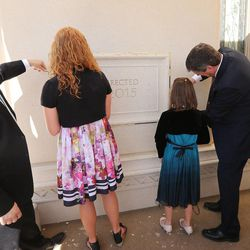 Youths place mortar in the cornerstone at the Payson Utah Temple cornerstone ceremony in Payson  Sunday, June 7, 2015.