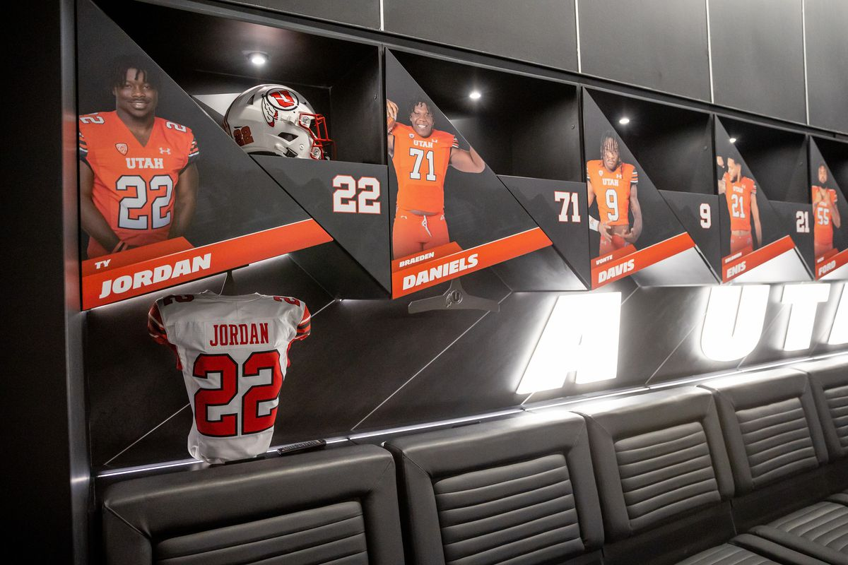 Ty Jordan's retired jersey is displayed inside the home team locker room in the new Ken Garff Red Zone at Rice-Eccles Stadium.