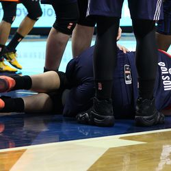 Washington Mystics' Stefanie Dolson lies on the floor are being elbowed in the face.