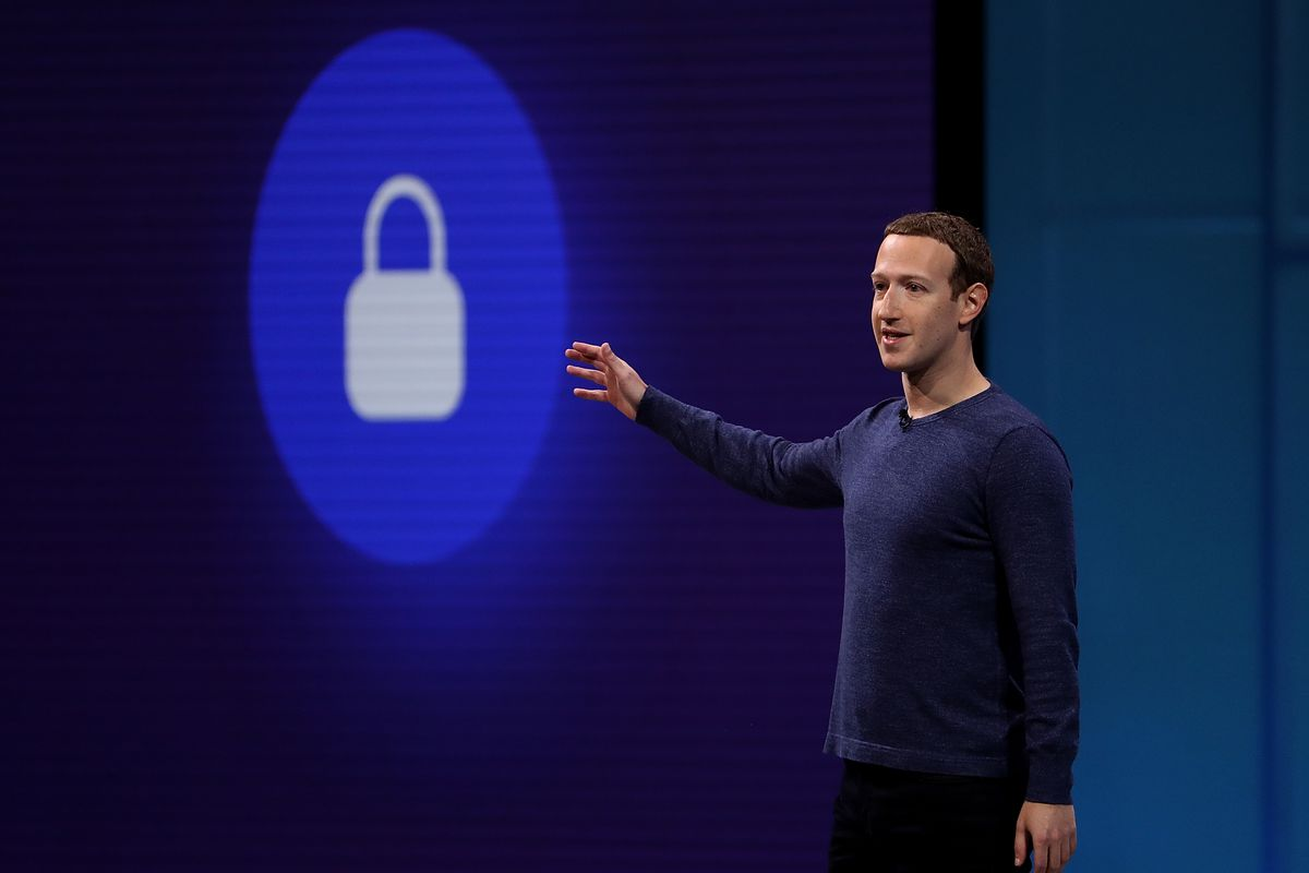 Mark Zuckerberg addresses F8 while pointing at a lock symbol