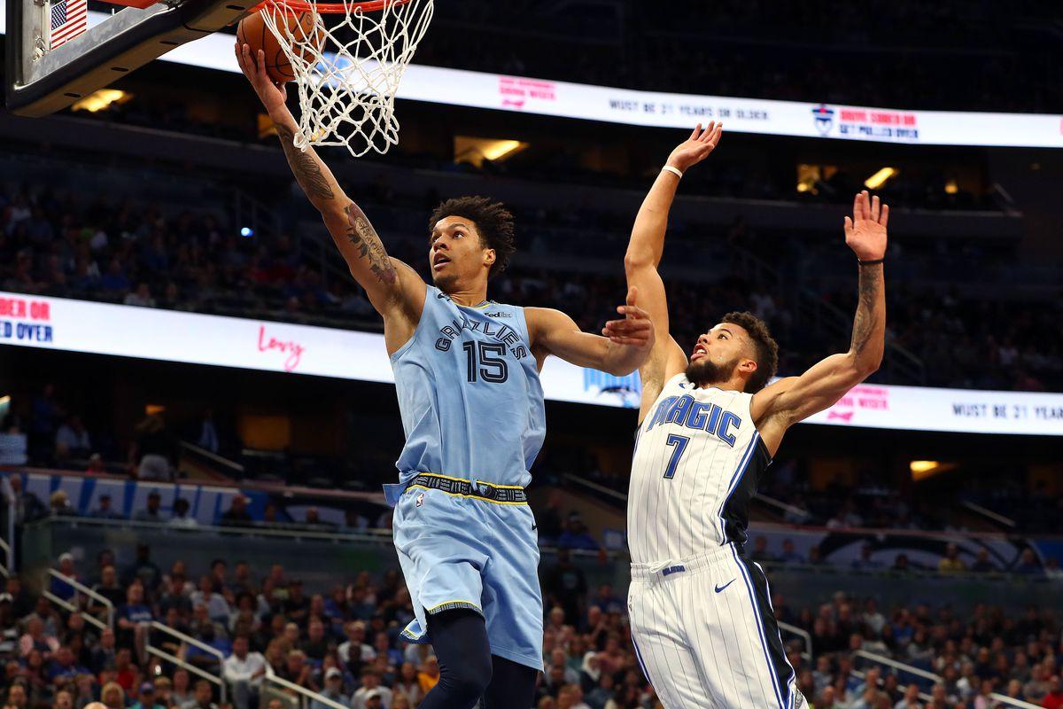 Memphis Grizzlies forward Brandon Clarke layups over Orlando Magic guard Michael Carter-Williams during the second half at Amway Center.