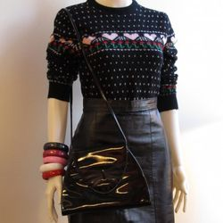 This cute little ensemble includes a high waisted, leather mini skirt (1970s) - $17.50, a heart patterned sweater (1980s) - $17.50, an assortment of bangles - $5 each, and a black patent leather purse $12.  Garments are size small