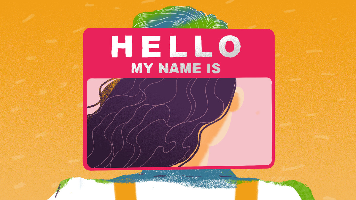 """""""Hello My Name Is"""" nametag affixed over a woman."""