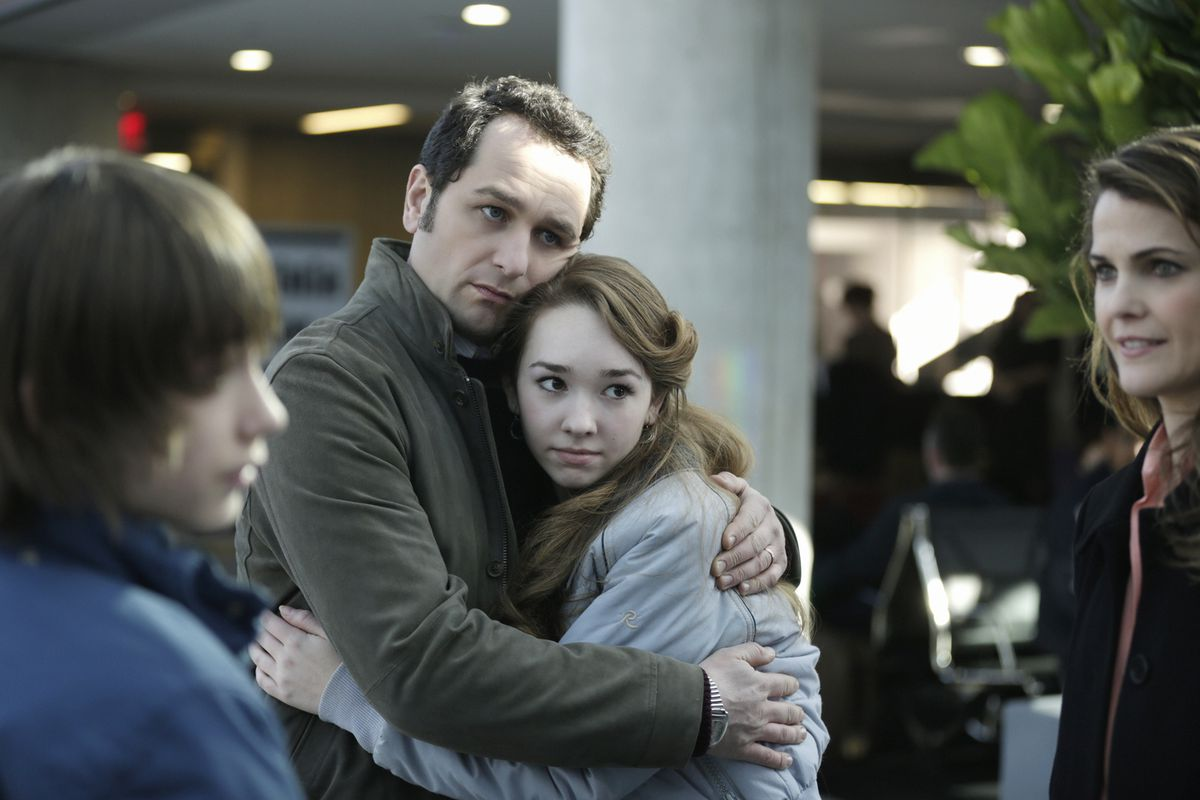 Philip (Matthew Rhys) embraces his daughter Paige (Holly Taylor) before she and her mother go on a trip.