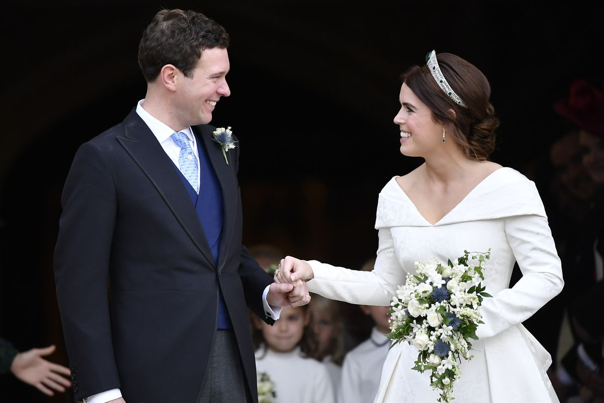 dfdacd00a4 Jack Brooksbank and Princess Eugenie of York at their wedding at St.  George s Chapel. Toby Melville Getty Images ...