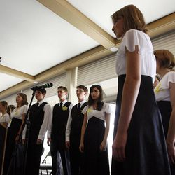 Rowland Hall Upper School Choir performs a musical postlude at the end of a Utah Holocaust Memorial Commemoration at the Jewish Community Center in Salt Lake City, Thursday, April 19, 2012.