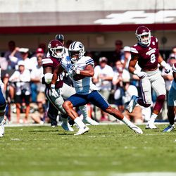 BYU wide receiver Jonah Trinnaman, center, runs with the ball during the first half against Mississippi State at Davis Wade Stadium in Starkville, Miss., on Saturday, Oct. 14, 2017.