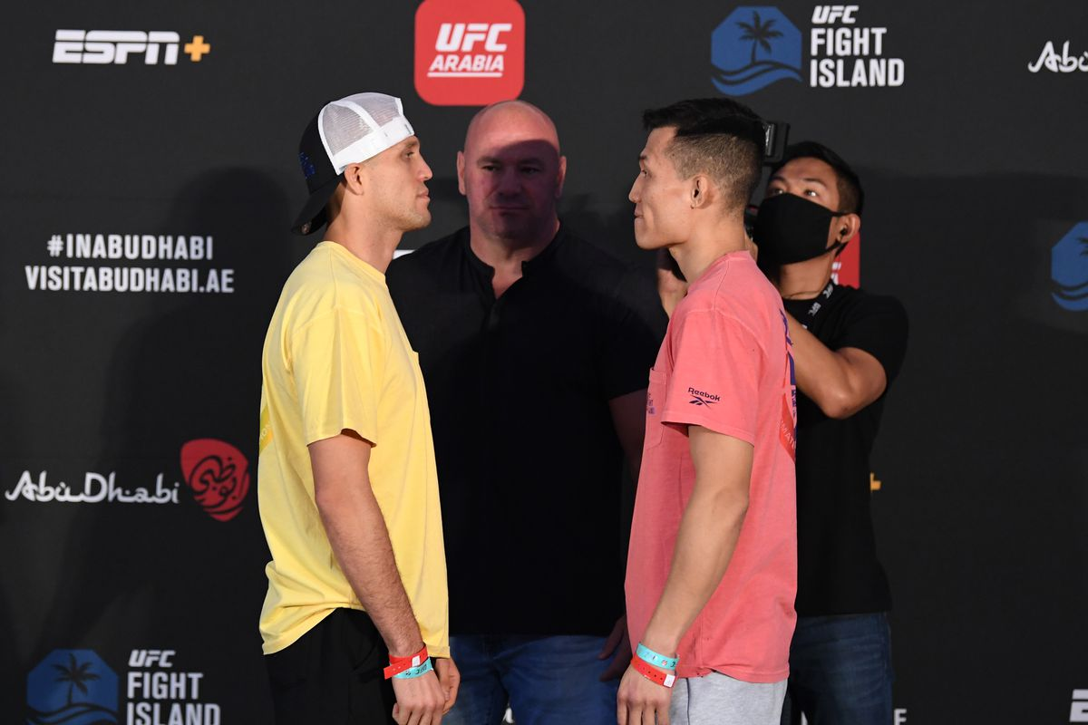 """Opponents Brian Ortega and """"The Korean Zombie"""" Chan Sung Jung of South Korea face off during the UFC Fight Night weigh-in on October 16, 2020 on UFC Fight Island, Abu Dhabi, United Arab Emirates."""