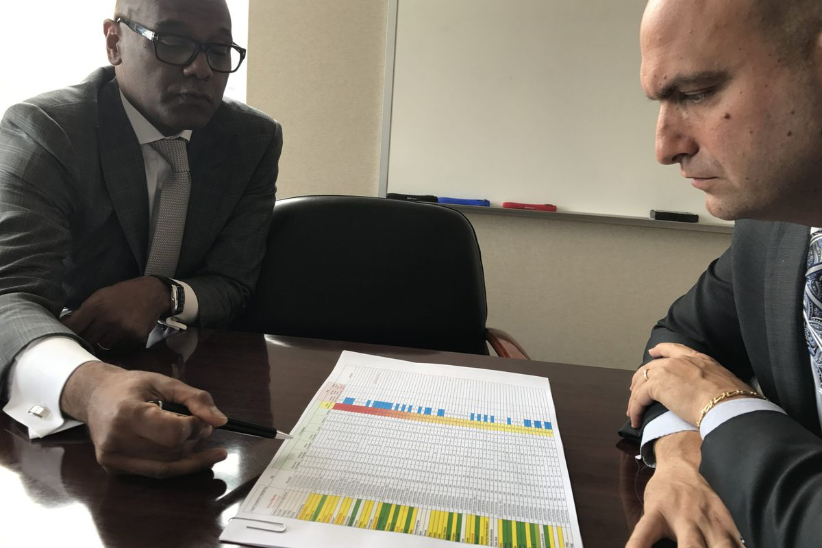 Detroit School Superintendent Nikolai Vitti consults with Luis Solano, the district's new chief operating officer, on a new system to improve school building maintenance. Solano is among people Vitti knew from Florida who he's recruited to come work in Detroit.