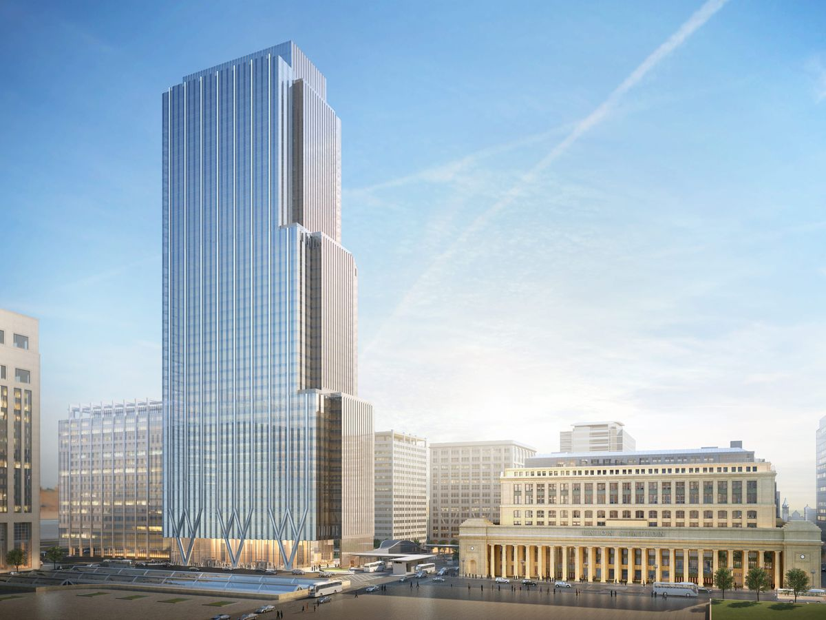 A rendering of a glassy downtown office tower next to a historic Beaux Arts train station.