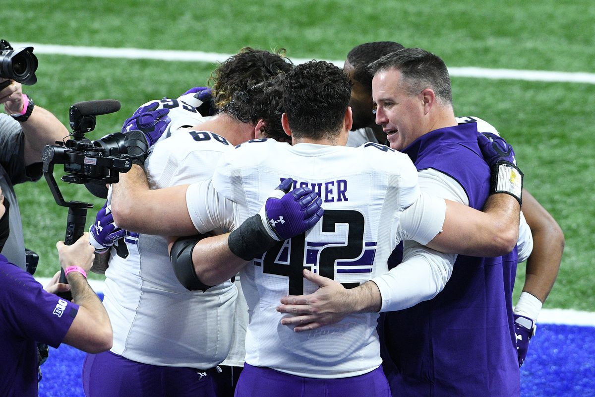 Northwestern Wildcats head coach Pat Fitzgerald huddles up with his players before the start of the Big Ten Conference Championship football game between the Northwestern Wildcats and the Ohio State Buckeyes on December 19, 2020, at Lucas Oil Stadium in Indianapolis, Indiana.