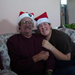 Sarah Robles, right, sits next to her father, Dennis.