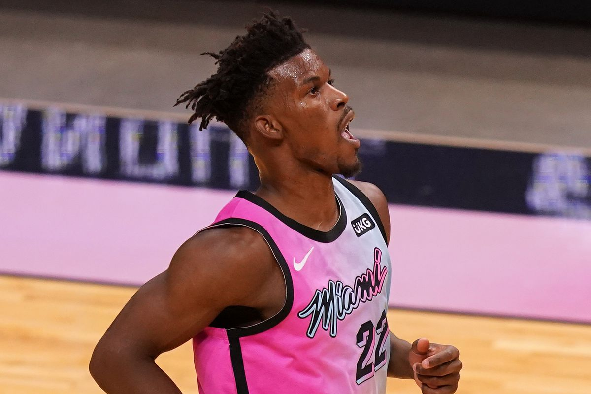Miami Heat forward Jimmy Butler reacts after making a basket and being fouled by Philadelphia 76ers forward Danny Green (14, not pictured) during the first half at American Airlines Arena.