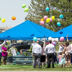 Family members of Tony and Katherine Butterfield release balloons as they gather in the Herriman City Cemetery for graveside services on Saturday, April 25, 2020.The couple was shot and killed at their home in West Jordan on Saturday, April 18, 2020. Albert Enoch Johnson was arrested the following Wednesday in Stockton, California, in connection with the Butterfields' deaths.