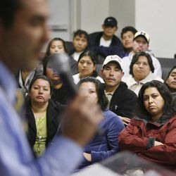 Members of the Latino community in the Hyrum area listen to Jorge Sanchez, Multi-cultural affairs coordinator for Department of Workforce services during a town meeting in Hyrum, UT December 13, 2006 to address concerns and issues surrounding the raid of the Swift & Co., a meat-packing plant in Hyrum December 12th by ICE agents targeting illegal workers.