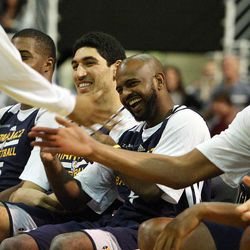 Trey Burke, left, jokes with other players after dancing before the Utah Jazz's scrimmage in Salt Lake City, Saturday, Oct. 5, 2013.