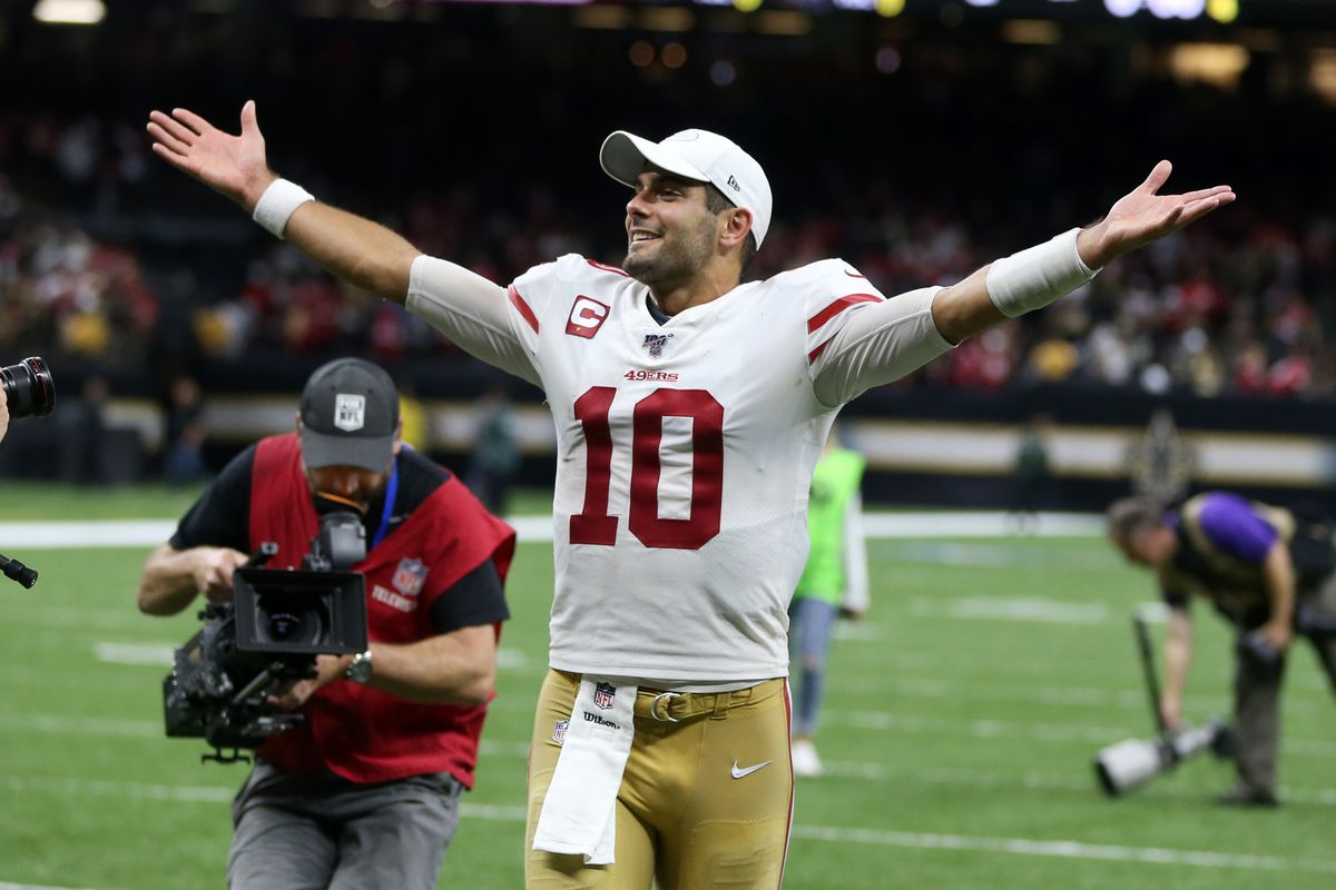 San Francisco 49ers quarterback Jimmy Garoppolo celebrates while leaving the field after defeating the New Orleans Saints at the Mercedes-Benz Superdome