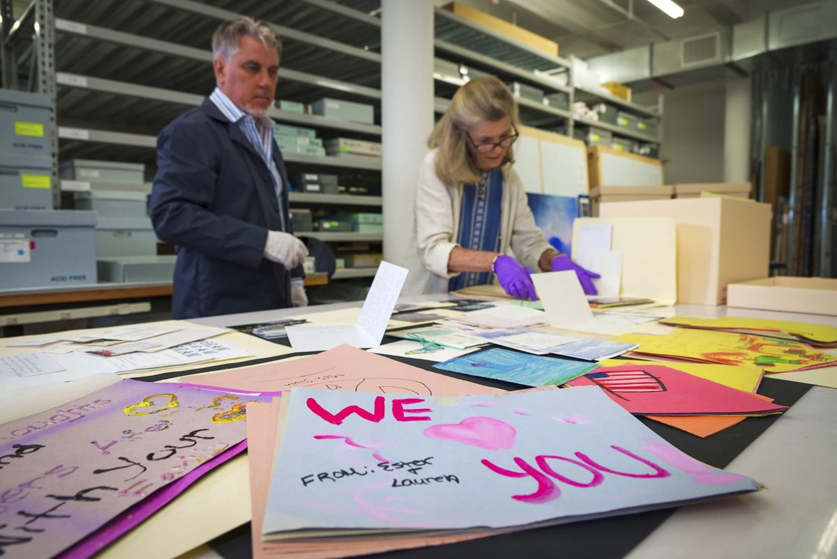 Jan Ramirez (right), chief curator at the 9/11 Memorial & Museum, sifts through a collection of condolence cards for a victim of the Sept. 11, 2001, attacks that were donated to the museum's archive. The museum has collected 22,000 personal artifacts to help tell the stories of those who died and those who were lucky to survive.