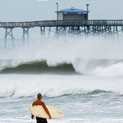A surfer from Atlantic Beach, N.C., watches the waves as Hurricane Isabel approaches the North Carolina coast on Wednesday.