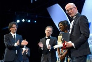 """Cannes Film Festival jury presidents Joel Coen (left) and Ethan Coen applaud """"Dheepan"""" director Jacques Audiard as he poses onstage with actress Kalieaswari Srinivasan after receiving the Palme D'Or on May 24.   Pascal Le Segretain/Getty Images"""