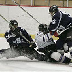 Weber's Dave Lorenzen falls between USU's Scotty John, left, and Roberto Leo.