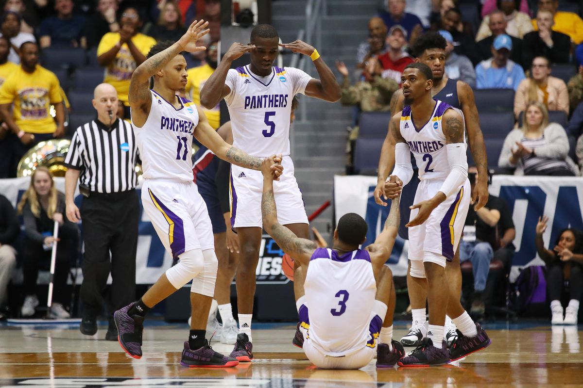 Gary Blackston of the Prairie View A&M Panthers is helped up by teammates during the second half against the Fairleigh Dickinson Knights in the First Four of the 2019 NCAA Men's Basketball Tournament at UD Arena on March 19, 2019 in Dayton, Ohio.