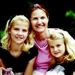 Lois Smart poses with her daughters, Elizabeth and Mary Katherine, before the family was ripped apart by the kidnapping.