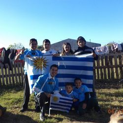 Noel Lopez poses for a photo with a family on his mission in Uruguay.