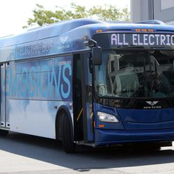 A model bus that is similar to five new zero-emission battery-electric buses from New Flyer that will be used in Salt Lake City is displayed outside the Utah Transit Authority offices in Salt Lake City on Tuesday, Aug. 2, 2016. The Utah Transit Authority has received a $5.4 million low- or no-emission vehicle deployment grant from the Federal Transit Administration.