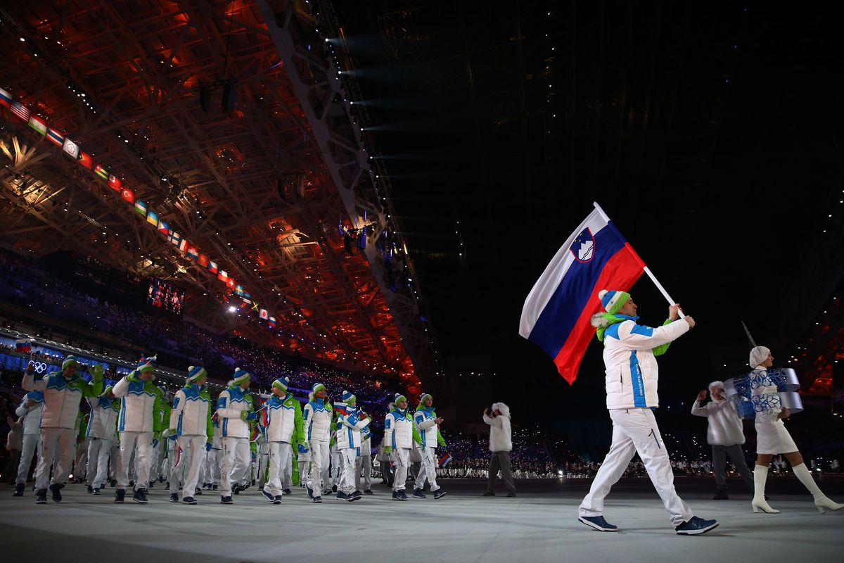Team captain Tomaz Razingar carries the Slovenian flag at the Opening Ceremony.