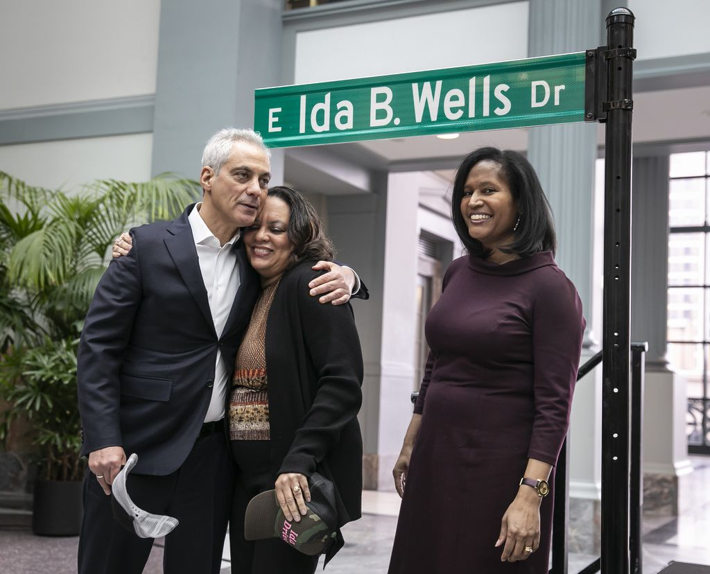 From left, Mayor Rahm Emanuel, Michelle Duster, great-granddaughter of Ida B. Wells and Ald. Sophia King after unveiling the Ida B. Wells Drive street sign at a ceremony at Harold Washington Library Monday.   Rich Hein/Sun-Times