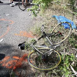 A damaged bicycle lies at the roadside after the accident.