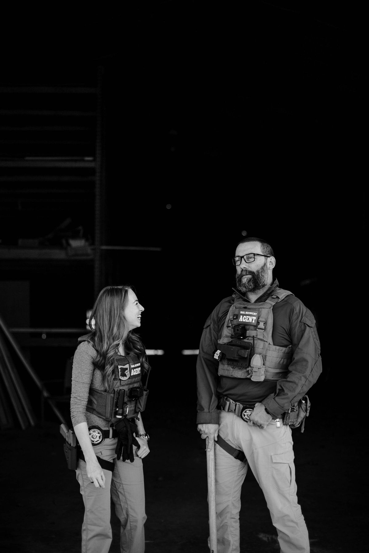 A man and a woman in protective gear, smiling.