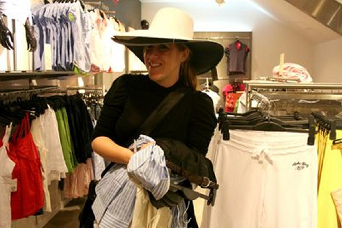 """Stocking up on hats at H&amp;M's Westside Pavilion opening. Image via <a href=""""http://blogs.laweekly.com/style_council/fashion/new-hm-opens-in-hipster-challe/"""">Style Council</a>"""