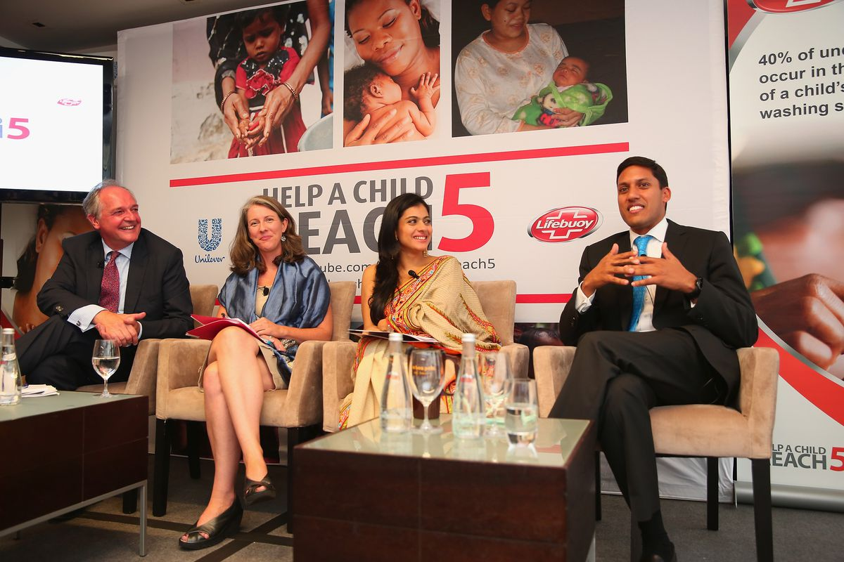 Former USAID administrator Raj Shah (right) hawks his campaign against child mortality in 2014.