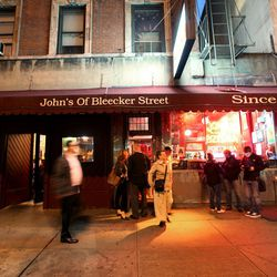 """<a href=""""http://ny.eater.com/archives/2012/10/solid_pies_plenty_of_locals_at_johns_of_bleecker_street.php"""">Who Goes There?: John's Pizzeria</a>"""
