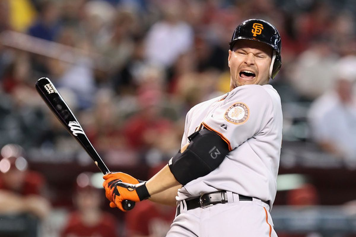Cody Ross reacts to Jerry Crawford's strike zone.