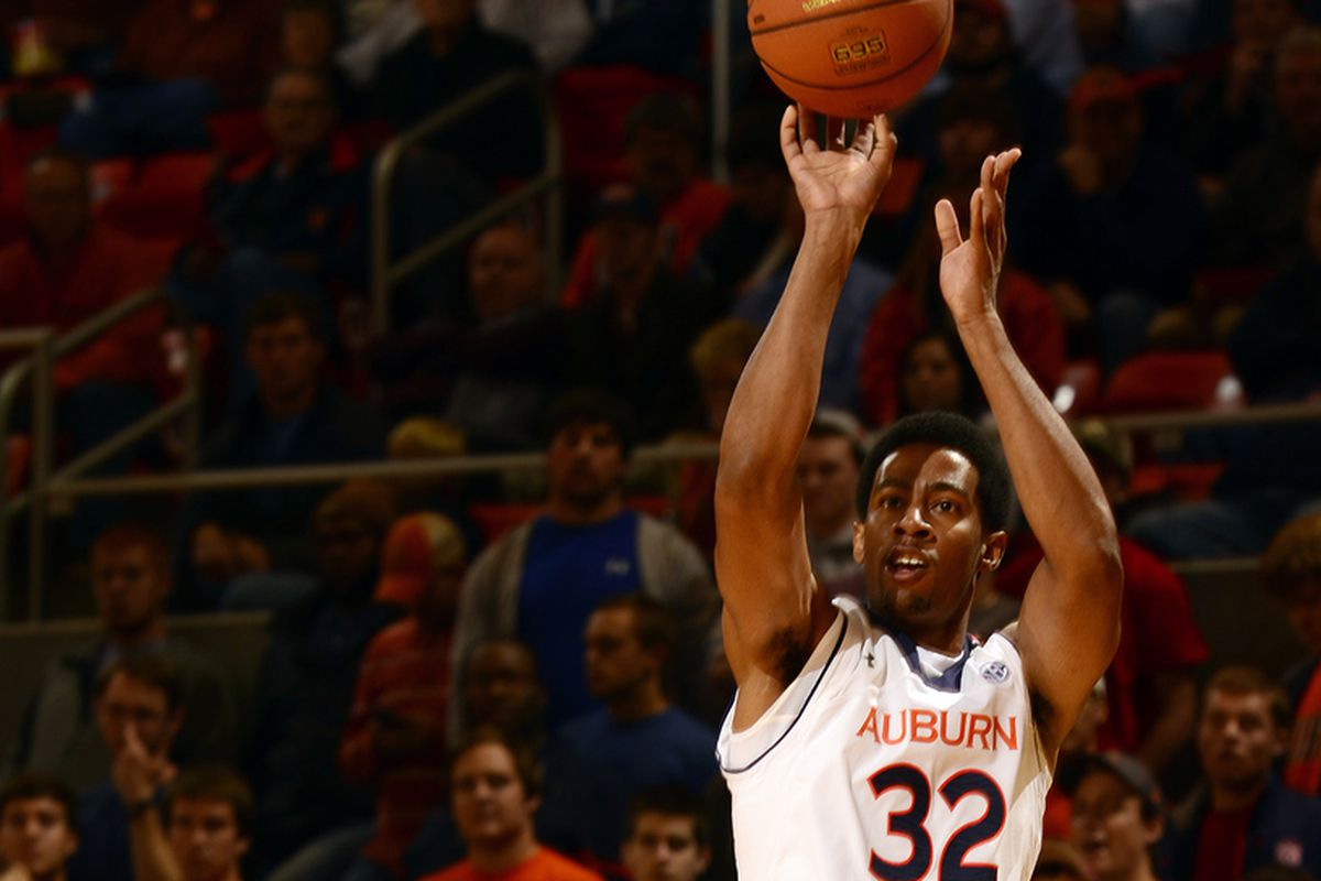 Auburn's Noel Johnson shoots over Victory's Travis Gibson in the first half of the Tigers' 108-57 exhibition win on Tuesday, Oct. 30.