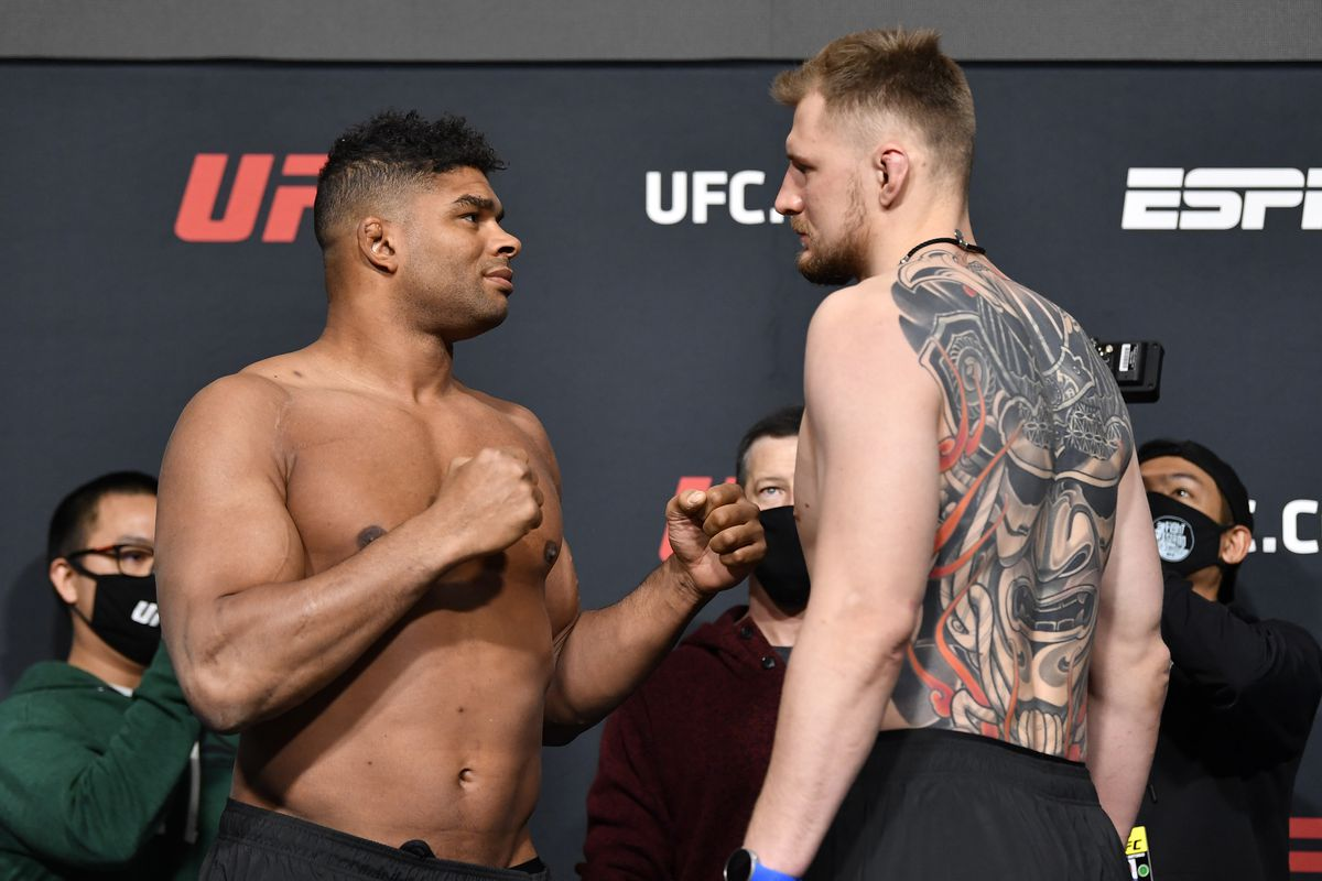 Opponents Alistair Overeem of the Netherlands and Alexander Volkov of Russia face off during the UFC weigh-in at UFC APEX on February 05, 2021 in Las Vegas, Nevada.