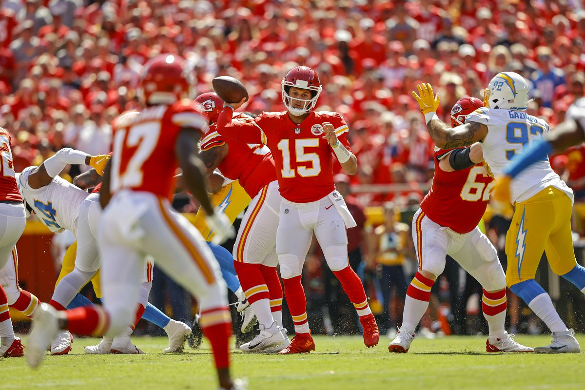 Patrick Mahomes #15 of the Kansas City Chiefs readies to throw a pass to Mecole Hardman #17 of the Kansas City Chiefs during the second quarter against the Los Angeles Chargers at Arrowhead Stadium on September 26, 2021 in Kansas City, Missouri.