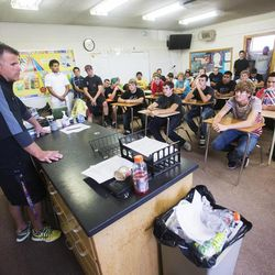 Coach Matt Labrum talks to his players after they provided some service time at the Uintah Basin Rehabilitation and Senior Villa in Roosevelt on Tuesday, Sept. 24, 2013. The football coaches at Union High School have taken a stand against poor performance in the classroom and bullying outside the classroom, including disrespect of teachers and students.