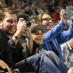 Niko Tinoco, Esteban Magallanes and Stella Magallanes watch Stella's daughter, Leecia Barajas, receive her degree during Salt Lake Community College's commencement at the Maverik Center in West Valley City on Friday, May 6, 2016.