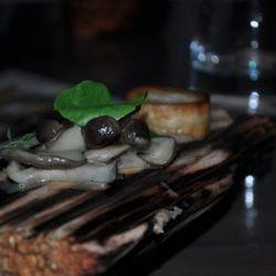 MUSHROOMS: on a log