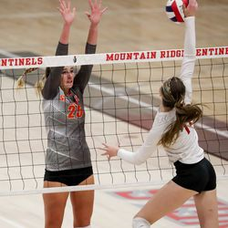 Skyridge's Rose Moore defends against a spike from Mountain Ridge's Rylee Parkinson in a girls volleyball match in Herriman on Tuesday, Sept. 7, 2021.