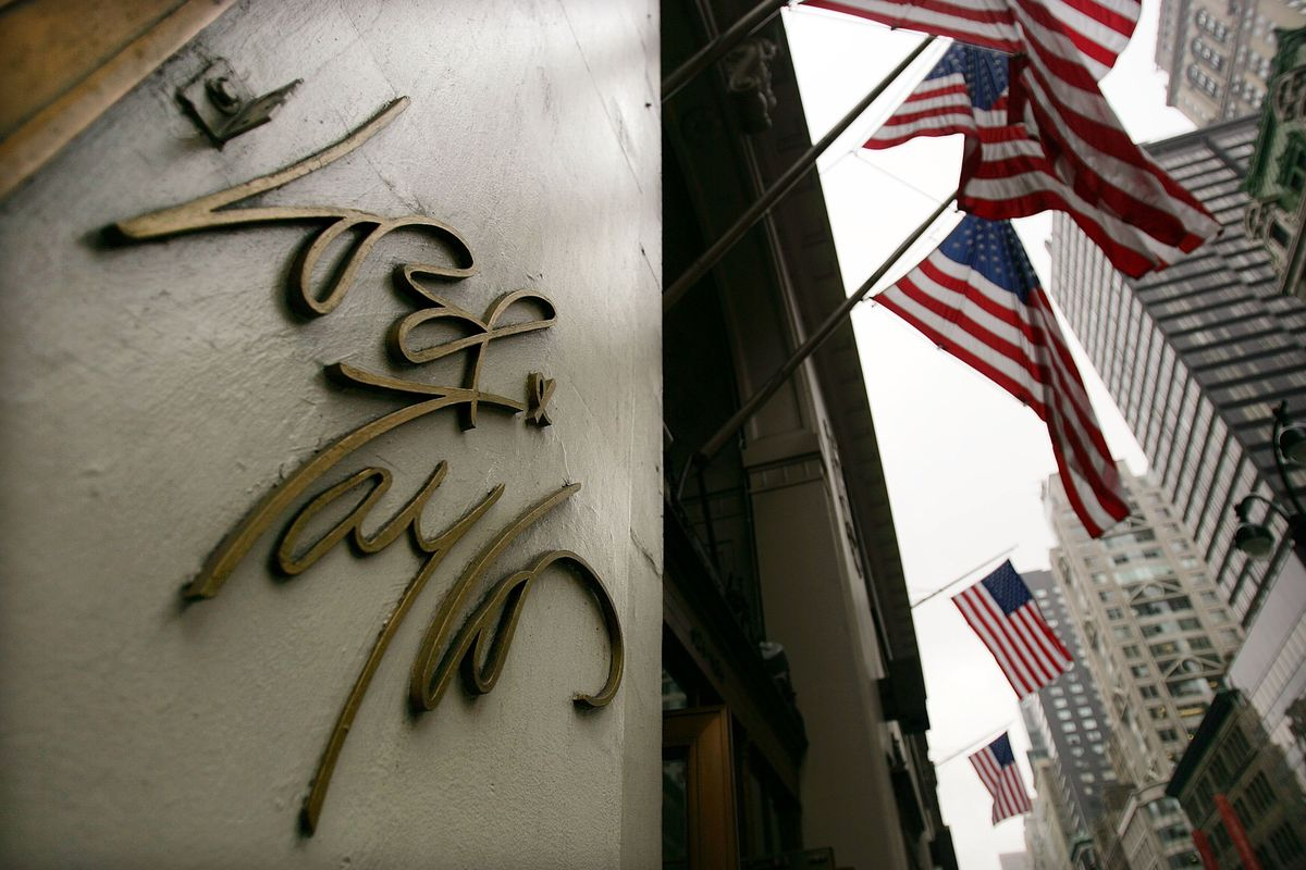 An external shot of the store, showing its logo and a line of American flags attached to the roof.
