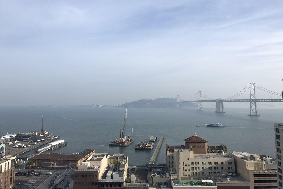 An unhealthy haze settles over the bay Friday morning.