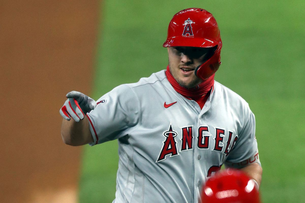 Mike Trout #27 of the Los Angeles Angels runs the bases after hitting a two-run home run in the first inning against the Texas Rangers at Globe Life Field on August 07, 2020 in Arlington, Texas.