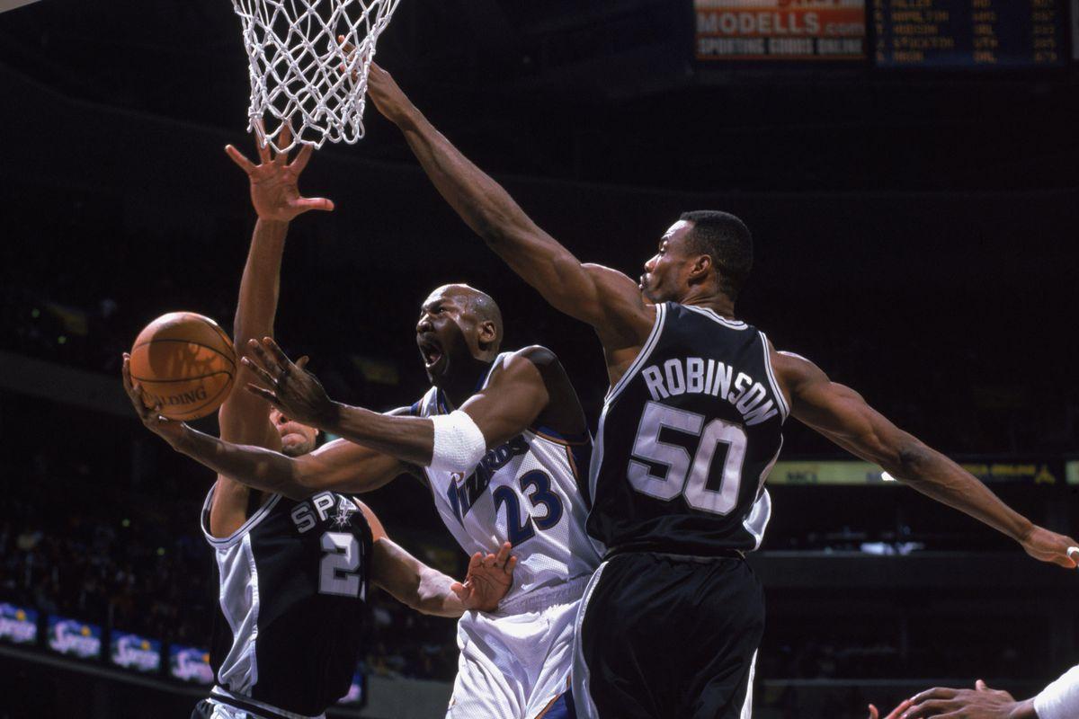 Michael Jordan shoots between David Robinson and Tim Duncan