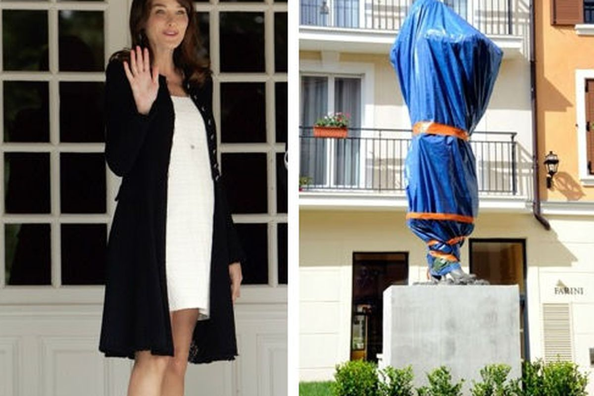The lady and the controversial statue, via Getty